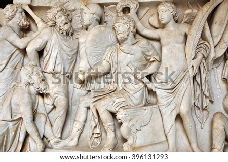 Bas-relief and sculpture of ancient Roman people - stock photo