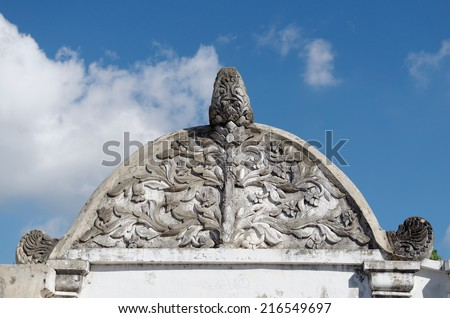 bas relief at top of the sumur gumantung, the underground stepway tunnel at taman sari water castle - the royal garden of sultanate of jogjakarta - stock photo
