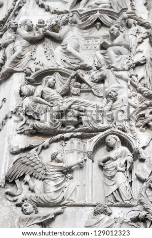 Bas-reliefs on an external wall of facade of the Cathedral (Duomo) with life scenes of Mary (mother of Jesus),Orvieto, Italy. The second pillar--the Messianic Prophesies - stock photo