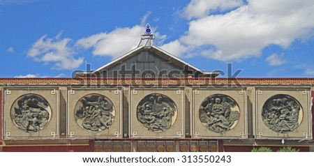 bas-reliefs on the building of former lenin museum in Ulaanbaatar, Mongolia - stock photo