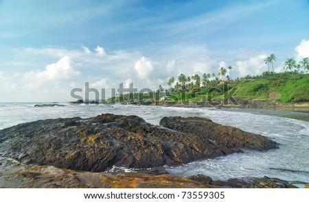 Basalt reefs near the tropical beach - stock photo