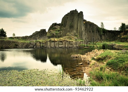 Basalt rock and pond - stock photo