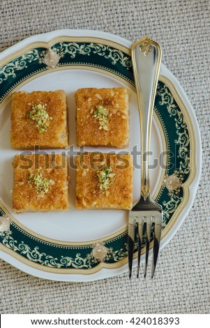 Basbousa - a middle eastern sweet made from semolina and sugar syrup. View from above. - stock photo