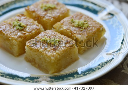 Basbousa - an arabic sweet made from semolina with sugar syrup. - stock photo