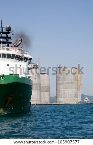 Base oil drilling platform and ocean going tug. Sea Japan. Russian coast. - stock photo