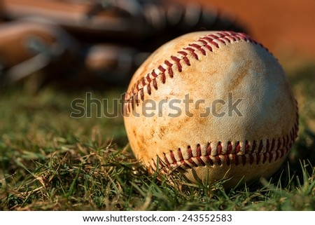 Baseball and Glove on Field - stock photo