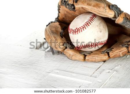 Baseball and mitt on a white grunge background - stock photo