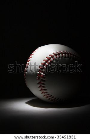 baseball ball in darkness - stock photo