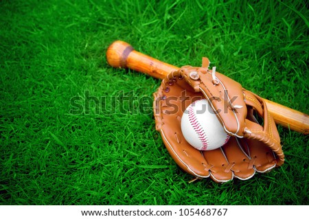 baseball bat, ball and glove on grass with copy space - stock photo