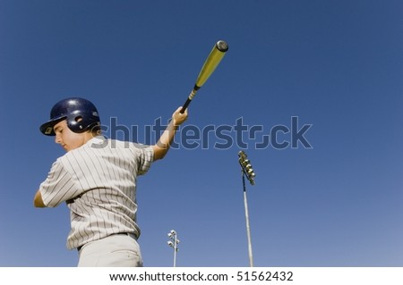 Baseball batter warming up in before match, (low angle view) - stock photo