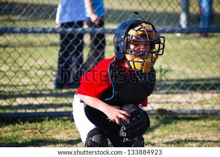 Baseball catcher looking at camera. - stock photo