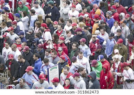 Baseball fans passing through ticket gates of Opening Game on March 31, 2008, at Citizen Bank Park where 44,553 attend as the Washington Nationals defeat the Philadelphia Phillies 11 to 6. - stock photo
