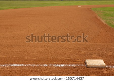 Baseball Field Third Base with the field beyond and room for copy - stock photo