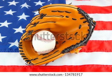 Baseball glove and ball on American flag background - stock photo