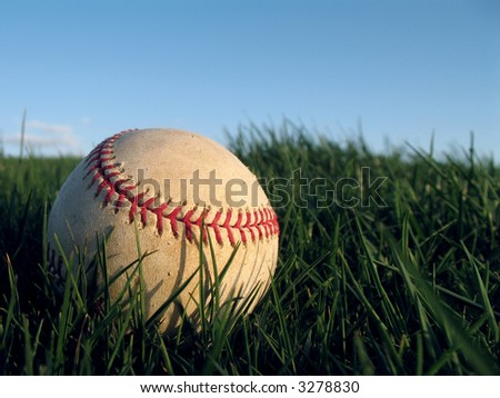 Baseball in Grass 3 of 7 - stock photo