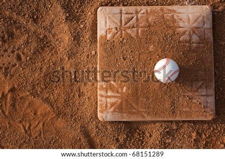 Baseball on a Infield Base - stock photo