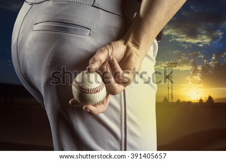 Baseball pitcher ready to pitch in an evening baseball game - stock photo