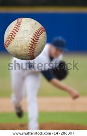 Baseball Pitcher Throwing focus on Ball - stock photo