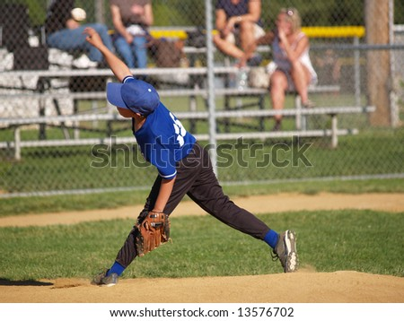 Baseball pitcher throwing the ball from the mound - stock photo