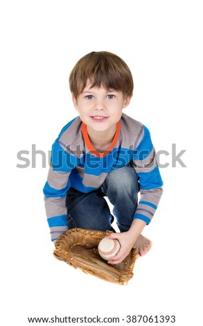 Baseball player: child catching a baseball in a mitt - stock photo