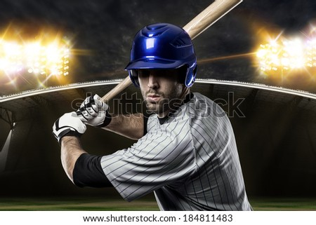 Baseball Player on a Blue Uniform on baseball Stadium. - stock photo