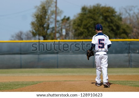 Baseball player taking the mound to pitch. - stock photo