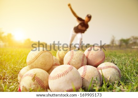 Baseball players to practice pitching outside - stock photo