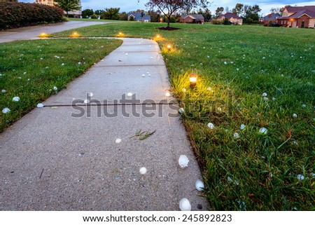 Baseball size hail covering the ground after the storm - stock photo