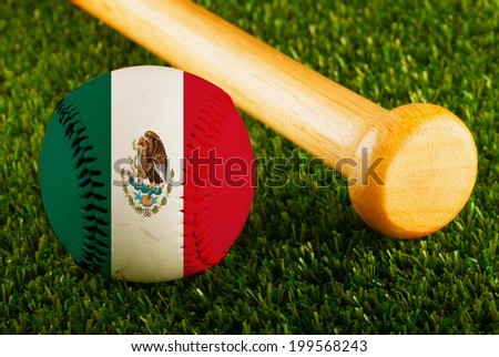Baseball with Mexico flag and bat over a background of green grass - stock photo