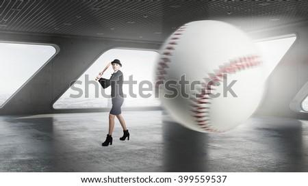 Baseball woman in interior - stock photo