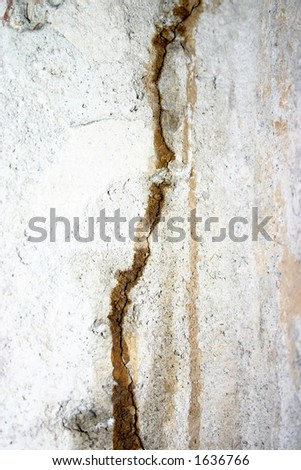basement wall with signs of current and past water damage - stock photo
