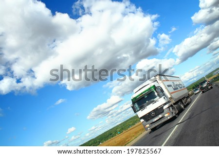 BASHKORTOSTAN, RUSSIA - AUGUST 22, 2010: White Mercedes-Benz Actros semi-trailer truck at the interurban road. - stock photo