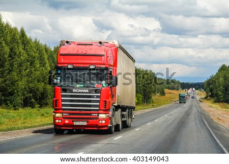 BASHKORTOSTAN, RUSSIA - JULY 28, 2012: Semi-trailer truck Scania R420 at the interurban road. - stock photo