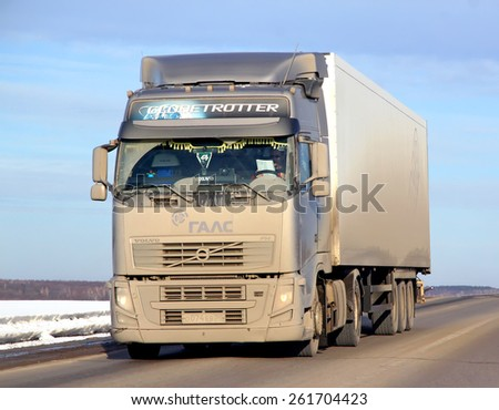 BASHKORTOSTAN, RUSSIA - MARCH 11, 2015: Very dirty semi-trailer truck Volvo FH12 at the interurban road. - stock photo