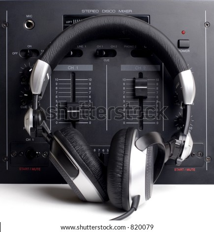 Basic DJ's setup with mixer and headphones. White space for text. - stock photo