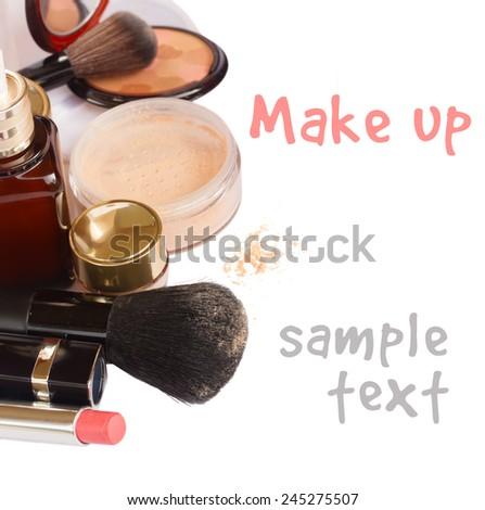 Basic make-up products - foundation, powder and lipstick isolated on white background - stock photo