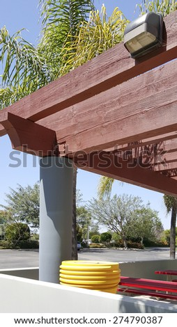 Basic wooden pergola with security light - stock photo