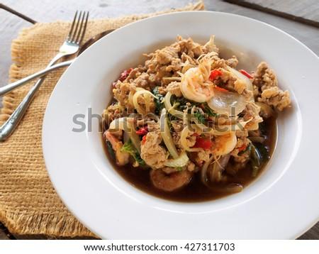 Basil fried pork chop on white dish, thai food style - stock photo