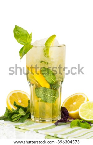 Basil, lemon and mint lemonade with ice. Cold summer drink. Isolated on white. Shallow focus - stock photo