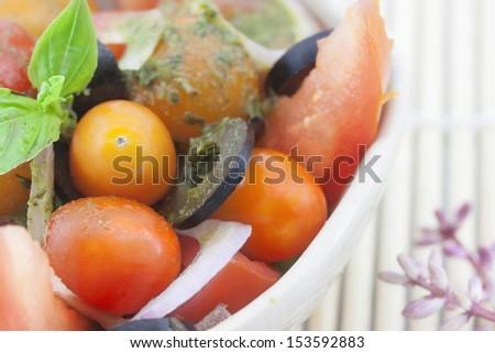 Basil tomato salad - stock photo