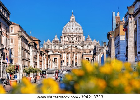 Basilica of Saint Peter in the Vatican with spring flowers, Rome, Italy - stock photo