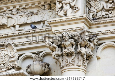 Basilica of Santa Croce or Church of the Holy Cross is a famous baroque church in Lecce, a historic city in Apulia, Southern Italy.  - stock photo
