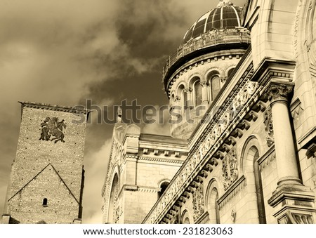 Basilica of St Martin and Charlemagne tower (remaining of huge early medieval basilica) at backgrounds in the old center of the city of Tours. (Val de Loire, France) Aged photo. Sepia. - stock photo