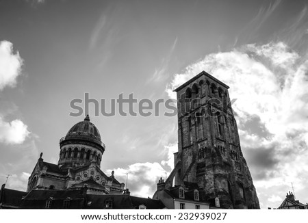 Basilica of St Martin and Charlemagne tower (remaining of huge early medieval basilica) in the old center of the city of Tours. (Val de Loire, France) Aged photo. Black and white. - stock photo