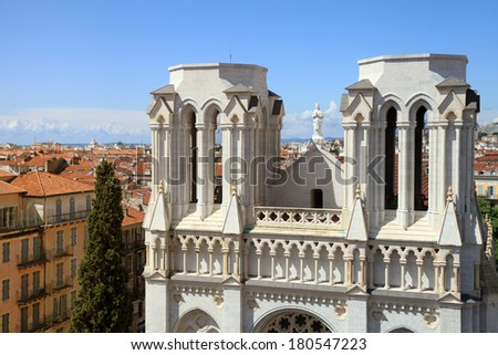 Basilique Notre Dame de Nice and red tile roofs of old houses, Nice, France. View from above - stock photo
