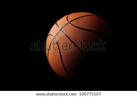 Basket ball in a dark background - stock photo