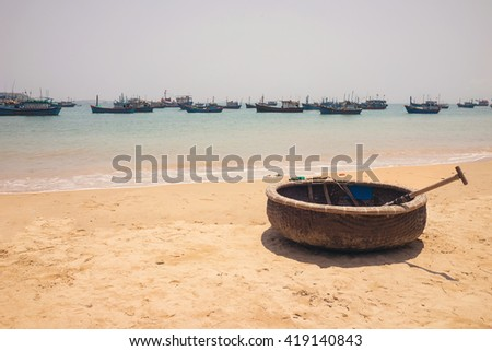 Basket boat on sea beach in Central Vietnam - stock photo