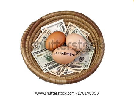 Basket egg with retirement eggs on US bank notes - stock photo