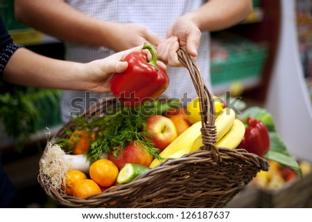 Basket filled healthy food - stock photo
