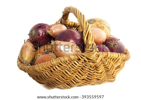 Basket filled with onion isolated over white - stock photo